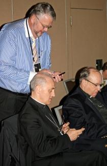 Apostolic Nuncio Archbishop Giuseppe Lazzarotto with an iPOD Touch